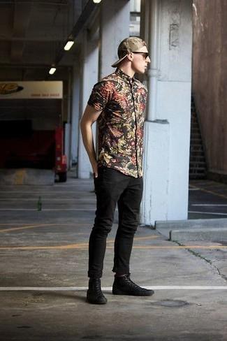 How to wear: olive baseball cap, black high top sneakers, black skinny jeans, black floral short sleeve shirt