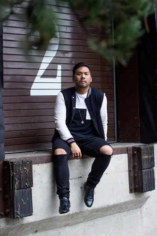 How to wear: black leather derby shoes, black ripped jeans, black and white geometric crew-neck t-shirt, black and white varsity jacket