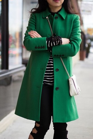 How to wear: white leather crossbody bag, black ripped jeans, black and white horizontal striped turtleneck, green coat