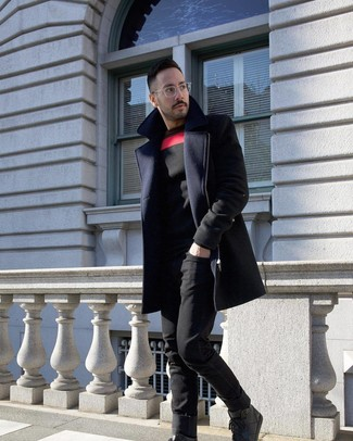 How to wear: black leather high top sneakers, black jeans, black print crew-neck sweater, navy overcoat