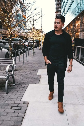 How to wear: brown suede cowboy boots, black jeans, black crew-neck t-shirt, black zip sweater