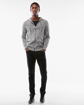 How to wear: black leather high top sneakers, black jeans, black crew-neck t-shirt, grey hoodie