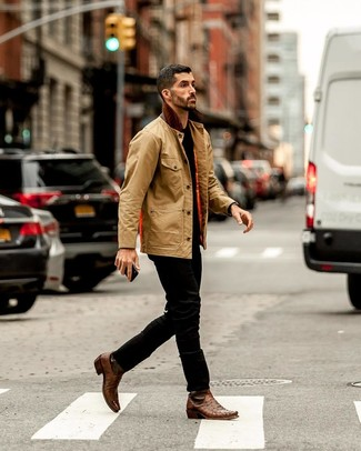 How to wear: brown leather cowboy boots, black jeans, black crew-neck t-shirt, tan barn jacket