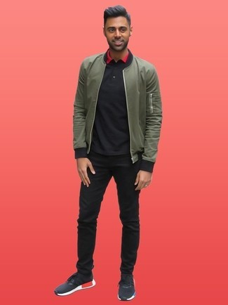 How to wear: black athletic shoes, black jeans, black polo, olive bomber jacket