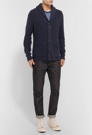 How to wear: beige canvas high top sneakers, black jeans, blue horizontal striped crew-neck t-shirt, navy shawl cardigan