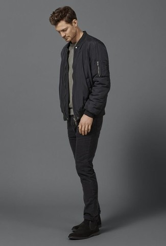 How to Wear a Black Bomber Jacket For Men: This relaxed combo of a black bomber jacket and black jeans is very easy to pull together in seconds time, helping you look awesome and ready for anything without spending a ton of time searching through your wardrobe. To introduce a little classiness to this ensemble, complete your ensemble with black suede chelsea boots.