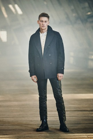 How to wear: black leather casual boots, black leather jeans, white cable sweater, navy pea coat