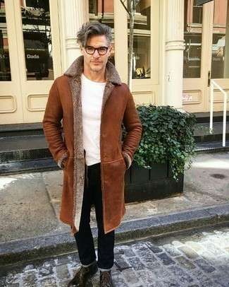 How to Wear Dark Brown Leather Casual Boots For Men: A tobacco shearling coat and black jeans have become must-have casual styles for most men. Dark brown leather casual boots will add a refined aesthetic to the outfit.