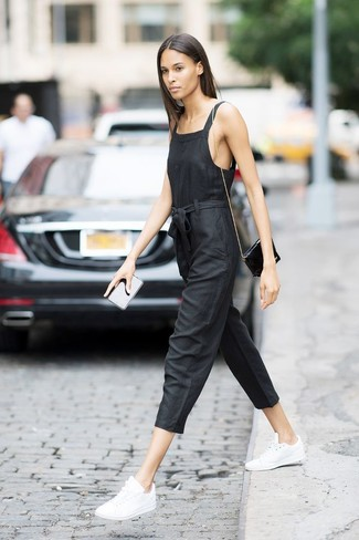 How to wear: black jumpsuit, white leather low top sneakers, black leather crossbody bag