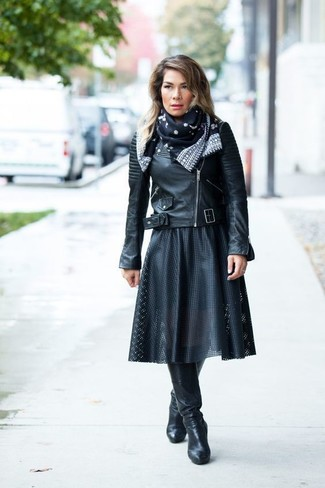 How to wear: black and white print silk scarf, black leather knee high boots, black pleated leather midi skirt, black leather biker jacket