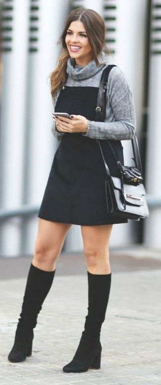 How to wear: black leather crossbody bag, black suede knee high boots, black denim overall dress, grey cowl-neck sweater
