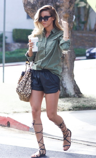 How to Wear Black Leather Shorts For Women: A dark green dress shirt and black leather shorts are a nice combination to take you throughout the day and into the night. Black leather knee high gladiator sandals will add a new dimension to a femme classic look.