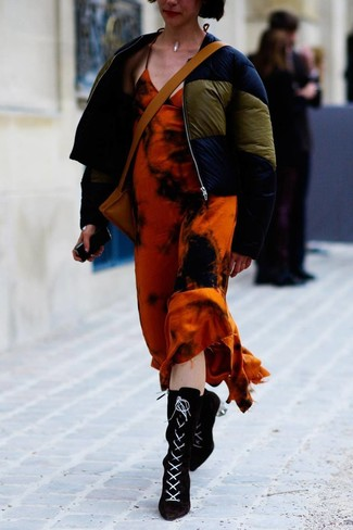 How to wear: tan leather crossbody bag, black suede lace-up ankle boots, orange tie-dye maxi dress, navy puffer jacket