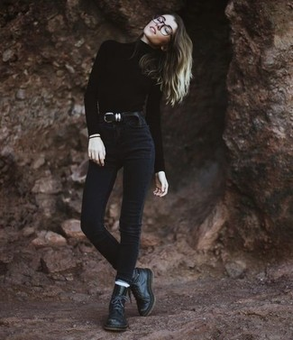 How to wear: black leather belt, black leather lace-up flat boots, black skinny jeans, black turtleneck