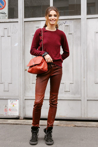 How to wear: red leather crossbody bag, black suede lace-up flat boots, brown leather skinny pants, burgundy crew-neck sweater