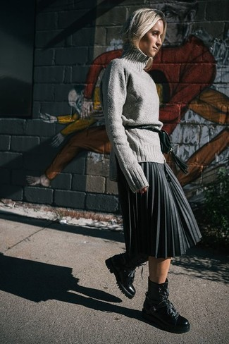 How to wear: dark green leather fanny pack, black leather lace-up flat boots, charcoal pleated midi skirt, grey wool turtleneck
