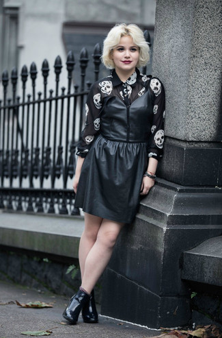 How to wear: black leather ankle boots, black and white print chiffon dress shirt, black leather tank dress