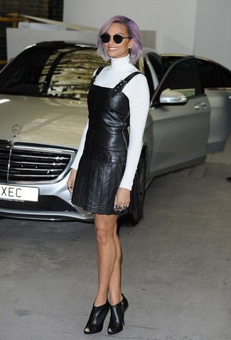 How to wear: black cutout leather ankle boots, black leather overall dress, white turtleneck