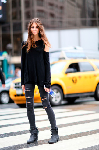 How to wear: black leather ankle boots, charcoal ripped skinny jeans, black long sleeve t-shirt