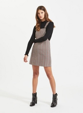 How to wear: black leather ankle boots, grey plaid overall dress, black crew-neck sweater