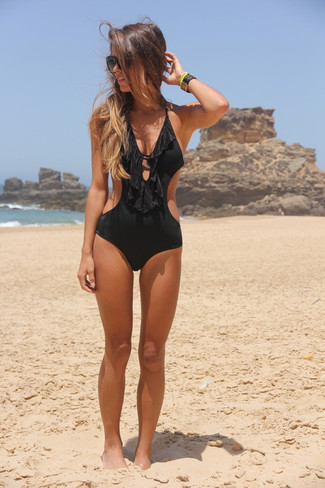 How to wear: black leather bracelet, black sunglasses, black cutout swimsuit