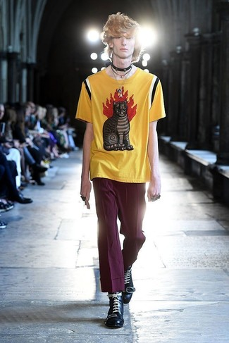 How to Wear Purple Chinos: This laid-back combo of a yellow print crew-neck t-shirt and purple chinos is a never-failing option when you need to look laid-back and cool but have zero time. Amp up this whole look by sporting black leather casual boots.