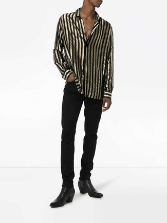 How to wear: black leather chelsea boots, black jeans, black and gold vertical striped long sleeve shirt