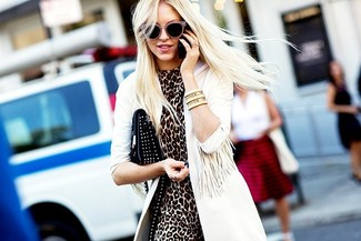 How to wear: black studded leather clutch, brown leopard sheath dress, white trenchcoat