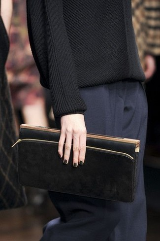 How to wear: black leather clutch, navy dress pants, black crew-neck sweater
