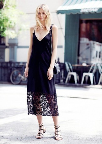 How to wear: black quilted leather crossbody bag, black embellished leather gladiator sandals, black lace cami dress