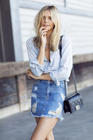 How to wear: black quilted leather crossbody bag, blue ripped denim mini skirt, light blue dress shirt