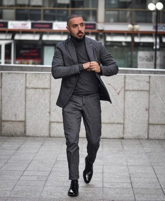 How to wear: black leather derby shoes, charcoal turtleneck, charcoal suit
