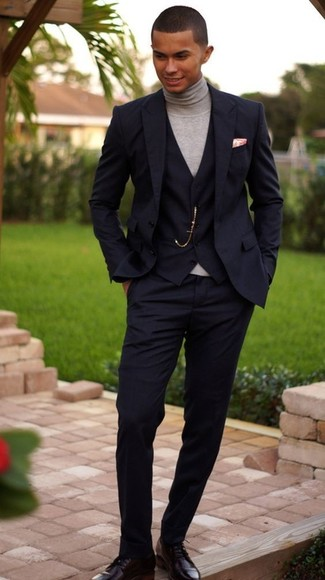 How to Wear a Black Three Piece Suit: The sartorial collection of any gentleman should always include such mainstays as a black three piece suit and a grey turtleneck. Black leather derby shoes are a wonderful idea to complete your look.