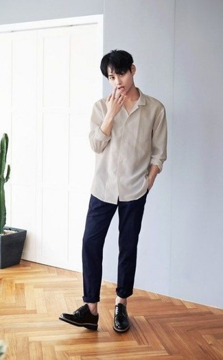 Men's Looks & Outfits: What To Wear In 2020: Pair a beige long sleeve shirt with navy chinos to create a casually dapper outfit. If you need to effortlesslly dress up your outfit with a pair of shoes, rock a pair of black leather derby shoes.