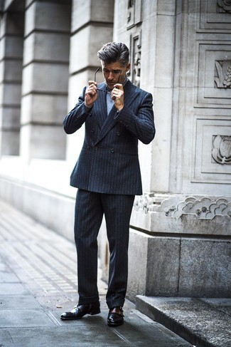 Men's Looks & Outfits: What To Wear In 2020: If the situation calls for a casually refined look, you can opt for a charcoal vertical striped wool suit and a grey turtleneck. On the fence about how to complement your look? Wear black leather double monks to rev up the style factor.