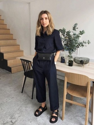How to wear: black leather fanny pack, black leather flat sandals, black jumpsuit