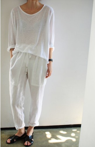 How to wear: black leather flat sandals, white pajama pants, white long sleeve t-shirt