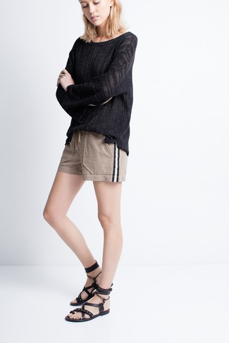 How to wear: black leather gladiator sandals, beige shorts, black oversized sweater
