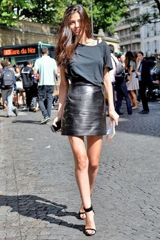 How to wear: black leather heeled sandals, black leather mini skirt, charcoal crew-neck t-shirt