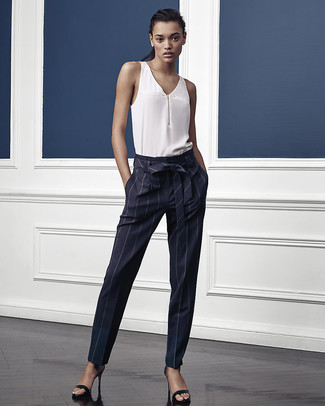 How to wear: black leather heeled sandals, navy vertical striped tapered pants, white silk sleeveless top