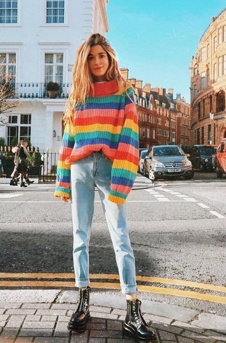 Women's Looks & Outfits: What To Wear In 2020: Show off your styling chops by opting for this relaxed casual pairing of a multi colored horizontal striped oversized sweater and light blue boyfriend jeans. To bring a little depth to your look, complete this ensemble with black leather lace-up flat boots.