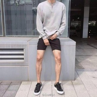 Men's Looks & Outfits: What To Wear In 2020: A grey zip neck sweater and black shorts are the kind of a never-failing casual getup that you need when you have zero time to spare. Black leather low top sneakers will add a carefree feel to an otherwise classic outfit.