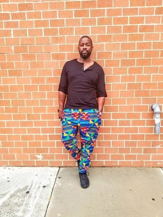 fa3f16fd01d9 How to wear: black leather low top sneakers, multi colored print  sweatpants, dark