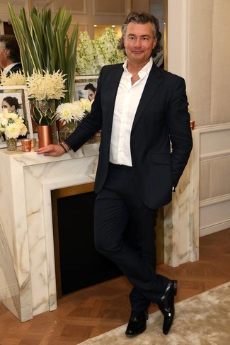 How to wear: black leather oxford shoes, white long sleeve shirt, navy suit