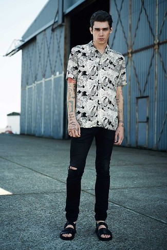 How to wear: black leather sandals, black ripped jeans, white and black floral short sleeve shirt