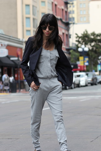 How to wear: black leather slip-on sneakers, grey jumpsuit, black vertical striped blazer