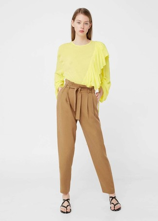 How to wear: black leather thong sandals, tan tapered pants, yellow long sleeve blouse