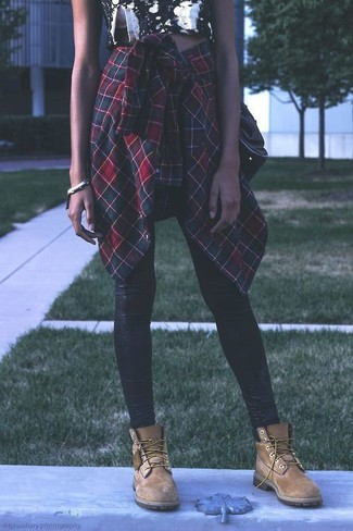 How to wear: tan suede lace-up flat boots, black leather leggings, black and white floral cropped top, green and red plaid dress shirt