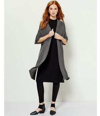 How to wear: black leather pumps, black leggings, black sweater dress, charcoal open cardigan