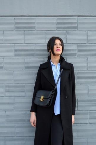 How to wear: black leather crossbody bag, black leggings, light blue chambray dress shirt, black coat